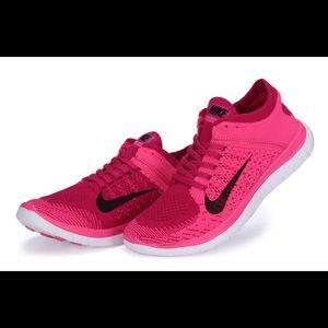 Pink Nike Free Flyknit